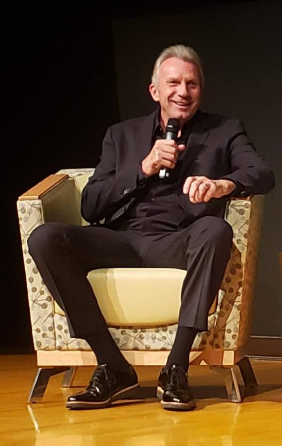 Joe Montana speaking at the Helene Glen Auditorium.