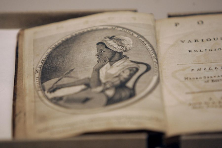 A copy of a book by Phillis Wheatley, the first book written by an African American.