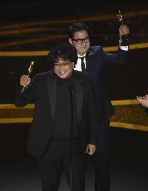 Bong Joon Ho, left, and Han Jin Won accept the award for best original screen-play for
