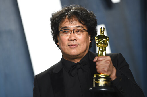Bong Joon-ho, winner of the awards for best original screenplay, best international feature film, best directing, and best picture for Parasite, arrives at the Vanity Fair Oscar Party on Sunday, Feb. 9, 2020, in Beverly Hills, Calif. (Photo by Evan Agostini/Invision/AP)