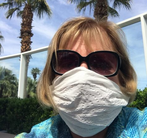 International film student Gail Pischak wearing a homemade mask at the Palm Springs International Airport.