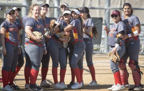 COD Softball celebrates after their victory against San Diego City on Jan. 31.