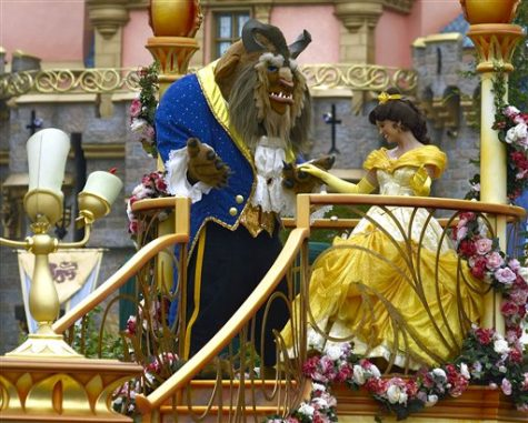 "Disney characters from the movie ""Beauty and the  Beast,"" Beast and Belle, dance during a parade along Main Street at Disneyland in Anaheim, Calif. May 4, 2005."