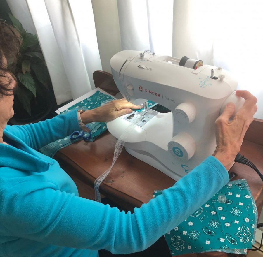 A+woman+sewing+cloth+masks+to+be+donated+to+people+in+the+neighborhood%2C+during+the+coronavirus+pandemic+in+New+York+City+on+April+6%2C+2020.