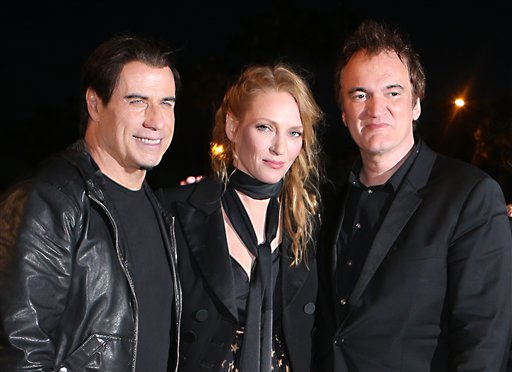 IMAGE DISTRIBUTED FOR MIRAMAX - John Travolta, Uma Thurman and Quentin Tarantino pose together ahead of the beach screening of Pulp Fiction at Miramax's 20th Anniversary celebration of the film at Majestic Beach in Cannes, southern France, during the 67th international film festival, Friday, May 23, 2014. (Photo by Joel Ryan/Invision for Miramax/AP Images)