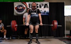 Bradley Buster Baird lifting weights. Photo courtesy of Hansel Villanueva Apuli