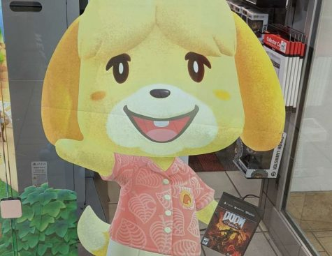 A humorous Gamestop display featuring Animal Crossing character Isabelle holding Doom Eternal.