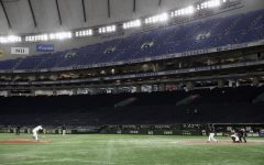 Photo courtesy of AP Images. In this Saturday, Feb. 29, 2020, file photo, spectators' stands are empty during play in a preseason baseball game between the Yomiuri Giants and the Yakult Swallows at Tokyo Dome in Tokyo.