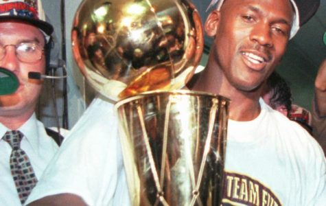 Chicago Bulls' Michael Jordan holds the NBA Championship trophy after the Bulls beat the Seattle SuperSonics 87-75 Sunday, June 16, 1996, in Chicago to win their fourth NBA Championship.