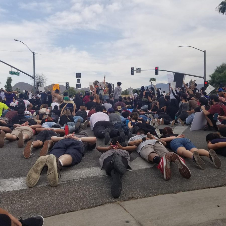 Protesters lay on the pavement while shouting