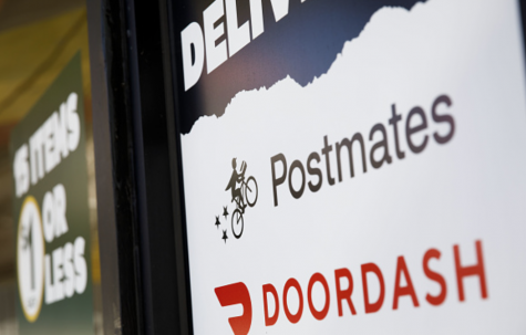 Photo courtesy of Gety Images. Postmates and Doordash provide people with food delivery options.