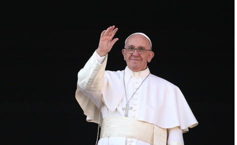 Photo courtesy of Getty Images. Pope Francis waves to the faithful as he delivers a blessing message at the Vatican.