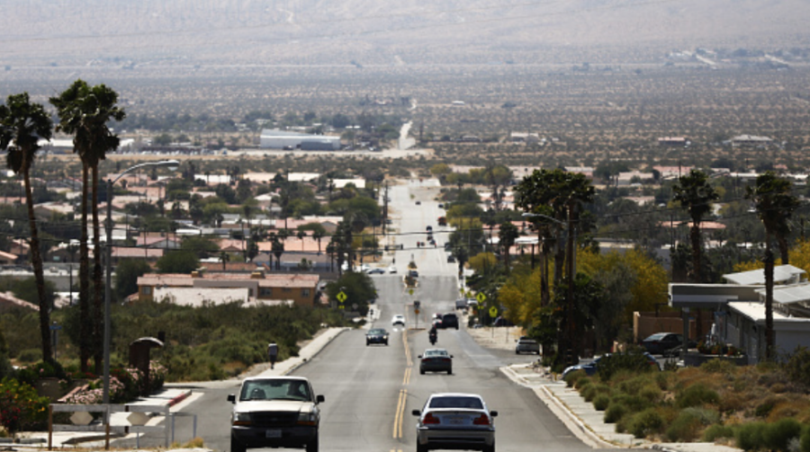 Photo courtesy of Getty Images. Cars driving on a Desert Hot Springs, Calif. street.