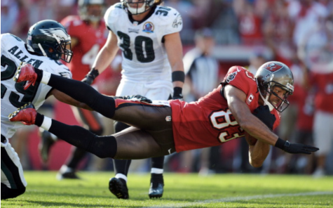 Photo courtesy of Getty Images by Drew Hallowell. Vincent Jackson #83 of the Tampa Bay Buccaneers dives into the end zone for a touchdown past Nate Allen #29 of the Philadelphia Eagles at Raymond James Stadium on Dec. 9, 2012 in Tampa, Fla.