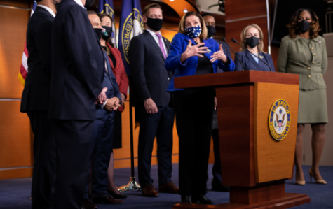 Photo courtesy of Graeme Sloan/Bloomberg at Getty Images. U.S. House Speaker Nancy Pelosi, a Democrat from California, center, wears a protective mask while speaking during a news conference with House impeachment managers at the U.S. Capitol in Washington, D.C., U.S., on Saturday, Feb. 13, 2021.