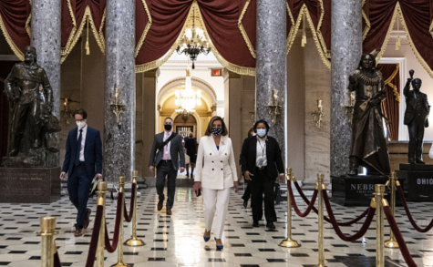 Photo courtesy of Samuel Corum/Getty Images. U.S. House Speaker Nancy Pelosi walks to her office from the House floor at the U.S. Capitol in Washington, D.C., U.S., on Wednesday, March 10, 2021. The House is poised to send the $1.9 trillion COVID-19 relief plan to President Biden for his signature.