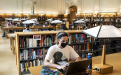 Photo courtesy of Getty Images. Students wearing protective face masks study inside of the Thompson Library at Ohio State University in Columbus, Ohio.