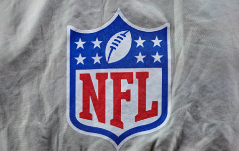 Photo courtesy of Robin Alam/ Getty Images. A detailed view of the NFL crest logo is seen on the back of a media vest in action during a game between the Chicago Bears and the Green Bay Packers on January 03, 2021 at Soldier Field in Chicago, IL.
