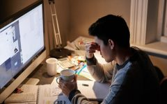 A young student studies for an exam late at night