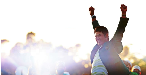 Photo by Mike Ehrmann/Getty Images.  Hideki Matsuyama of Japan celebrates during the Green Jacket Ceremony after winning the Masters at Augusta National Golf Club on April 11, 2021 in Augusta, Ga.