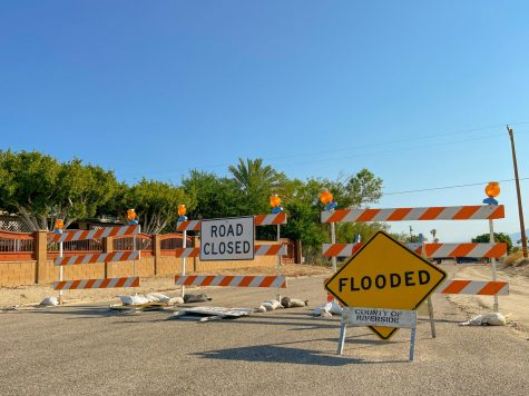 Photo Courtesy of The Chaparral/Marcela Carrillo. Road closed due to flooded streets in the North Shore community.