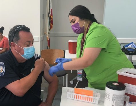 Photo Courtesy of College of The Desert. Public Safety officer, Robert Perez receiving the COVID-19 vaccine.